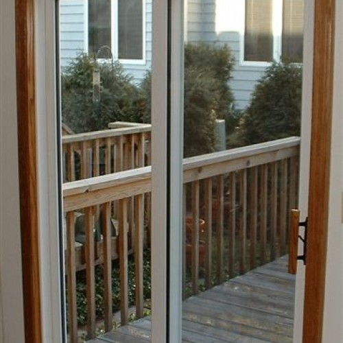 Vinyl patio door with stained trim